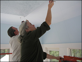 Kim and Pete Work On Ceiling